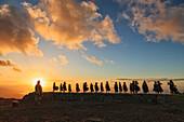 'Kumu Keala Ching leads performance of Na Wai Iwi Ola on hula platform (hula pahu) at Ka'ana on Molokai, legendary birthplace of hula; Island of Hawaii, Hawaii, United States of America'