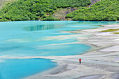 'Woman exploring the delta on Lake Louise in Banff National Park; Banff, Alberta, Canada'