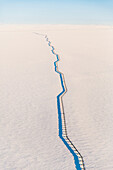 Aerial view of the Trans-Alaska Pipline passing over the snow covered tundra, Arctic Alaska, USA, Winter