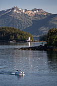 Scenic view of a lighthouse among the small islands in Sitka sound, Southeast Alaska, Summer