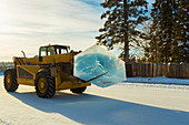 Ice blocks cut from a pond are moved and used for the BP World Ice Art Championships, Fairbanks, Interior Alaska, winter