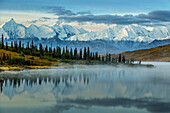 Scenic sunrise view over Mt. Brooks and the Alaska Range with fog over Wonder Lake in the foreground, Denali National Park, Interior Alaska, Autumn