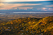 Scenic autumn view of the foothills of the Chugach Mountains and downtown Anchorage with the Alaska Range and Denali in the background, Southcentral Alaska