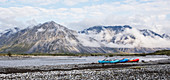 Rafts along the shore at sunrise on the Marsh Fork of the Canning River in the Arctic National Wildlife Refuge, Summer, Alaska