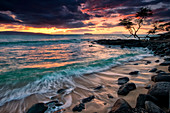 'A dramatic sky at sunset over a turquoise ocean along the coast of a hawaiian island; Hawaii, United States of America'