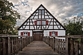 museum of local history in frame work house with a wooden bridge, Eselsburg valley, river Brenz valley around Herbrechtingen, Heidenheim district, Swabian Alb, Baden-Wuerttemberg, Germany