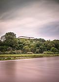 view across Danube river at open air museum Heuneburg, celtic settlement Pyrene, Hundersingen urban district of Herbertingen, Sigmaringen district, Swabian Alb, Baden-Wuerttemberg, Germany, long time exposure