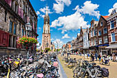 The Nieuwe Kerk, new church at the marketplace and the city hall on the left side with the typical accumulation of bicycles, Delft, Netherlands