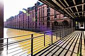 The Kehrwiedersteg bridge over the Kehrwiederfleet with the surrounding office houses in the warehouse district Speicherstadt, Hamburg, Germany