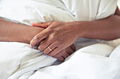 Woman's clasped hands, cropped