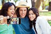 Friends taking selfie in park