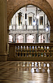 Arc of St. Alexander Cathedral entrance with his marble floor wich reflect lights and ancient parapet, Bergamo Alta, Lombardy, Italy