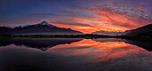 Panoramic view of Pian di Spagna flooded with snowy peaks reflected in the water at sunset Valtellina Lombardy Italy Europe