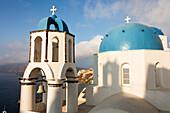The blue domes of the churches dominate the Aegean Sea Santorini Cyclades Greece Europe