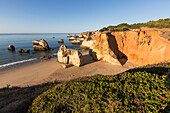 Top view of the sandy beach bathed by the blue ocean at dawn Praia do Alemao Portimao Faro district Algarve Portugal Europe