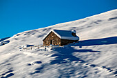 Orobie alps, Chalet in winter at Gerola valley, Lombardy, Italy