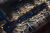 Aerial view of airplanes parked in airport gates