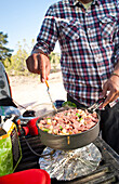 A camper cooks up breakfast on the tailgate of his truck outside the Grand Canyon.