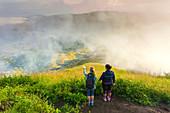 Two women hiker on the top of volcano Batur