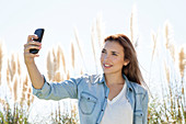 Woman posing for a selfie outdoors