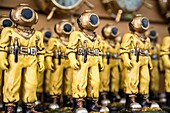 Diver Figurines Lined Up on a Shelf, Tarpon Springs, Florida.