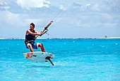 surfer on foilboard, new fast surfing sport - Foil boarding, Pointe d´Esny beach between Blue Bay and mahebourg, Grand Port District, Southeastern coast of Mauritius, Mauritius, Indian Ocean, Africa