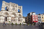 Tourists walk near the facade of the Cuenca´s Cathedral, The cathedral is dedicated to St Julian, gothic english-norman style, XII century, called the Basilica of Our Lady of Grace.