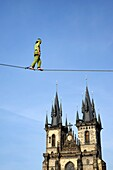 Czech Republic, Prague, historic centre listed as World Heritage by UNESCO, the Old Town (Stare Mesto), Old Town Square (Staromestske namesti), Our Lady of Tyn Church and a tightrope walker (funambulist).