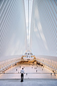 security inside the Oculus looking at passengers, futuristic train station by famous architect Santiago Calatrava next to WTC Memorial, Manhattan, New York City, USA, United States of America