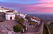 Sunrise over Marvao a famous medieval mountain village and tourist attraction in the Alentejo. Europe, Southern Europe, Portugal, Alentejo.