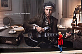 United Kingdom, London, Mayfair, pedestrian in front of a publicity for Louis Vuitton with Keith Richards (guitarist of the Rolling Stones)