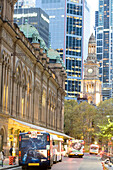 Australia, New South Wales, Sydney, Central business district, Queen Victoria Building shopping center and the Town Hall (end 19th century) in the background