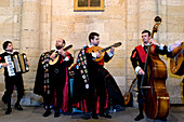 Spain, Galicia, Santiago de Compostela, listed as World Heritage by UNESCO, Los tunos, street singers and musicians with student outfit