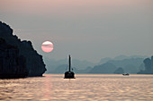 Vietnam, Along Bay, listed as World Heritage by UNESCO, sunset and junk