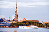 Latvia (Baltic States), Riga, European capital of culture 2014, historical centre listed as World Heritage by UNESCO, bell tower of St. John Church on Daugava River banks
