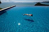 woman in Pool on Ko Yao Yai Island in the Andaman Sea, Thailand
