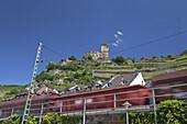Rail cargo underneath Burg Gutenfels Castle, Kaub, Upper Middle Rhine Valley, Rheinland-Palatinate, Germany, Europe