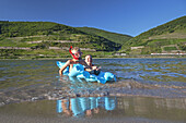 Kids swimming in the Rhine at the beach in Trechtingshausen, Upper Middle Rhine Valley, Rheinland-Palatinate, Germany, Europe