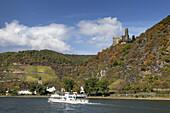 Excursion boat on the Rhine underneath Burg Maus castle, near St. Goarshausen, Upper Middle Rhine Valley, Rheinland-Palatinate, Germany, Europe