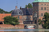 Sightseeing on a boat tour in front of castle Fredriksborg Slot in Hillerød, Island of Zealand, Scandinavia, Denmark, Northern Europe