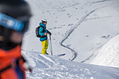Two young male skiers in the mountains apart the slopes, Andermatt, Uri, Switzerland