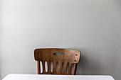 Wooden chair at a white wall, Andermatt, Uri, Switzerland