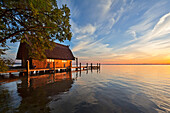 Boathouse at Lake Schwerin at sunset, Mecklenburg Lake District, Mecklenburg-West Pomerania, Germany