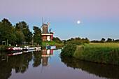 Twin windmills at full moon, Greetsiel, East Friesland, Lower Saxony, Germany