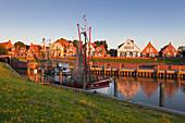 Fishing cutter in the harbour, Greetsiel, East Friesland, Lower Saxony, Germany