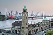 Jetties St. pauli-Landungsbrücken with tower Pegelturm, in the background port of Hamburg, Hanseatic City Hamburg, Northern Germany, Germany, Europe