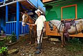 Nicaragua, El Castillo, the guide Alfonso Topia's Criollo horses are used for trip on Rio San Juan