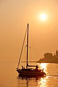 Croatia, Istria, Adriatic Coast, Rovinj, sailing boat and sunset