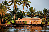 India, Kerala State, Allepey, the backwaters, houseboats (old transport barge converted for the touristic cruising of the canals)