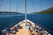 Passengers relax on deck of motor sailing cruise ship M/S Panorama (Variety Cruises), near Korcula, Dubrovnik-Neretva, Croatia